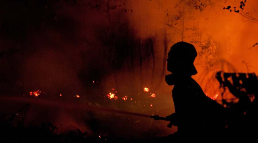 Firefighters fight the fire at night. Outside Palangka Raya, Central Kalimantan.